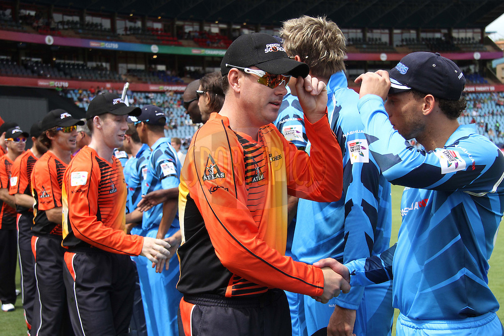 The players shake hands before the start during match 1 of the Karbonn Smart CLT20 South Africa between The Titans and The Perth Scorchers held at Supersport Park Stadium in Centurion, South Africa on the 13th October 2012..Photo by Shaun Roy/SPORTZPICS/CLT20