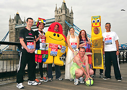 © under license to London News Pictures. 15/04/2010 Various Guinness world record attemptees attend a photocall ahead of this Sundays 2011 London Virgin Marathon by Tower Bridge London. Photo credit should read ALAN ROXBOROUGH /LNP