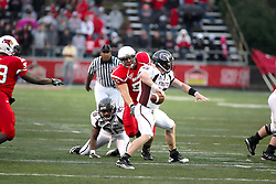 25 September 2010:  Eric Brunner closes in on a passing Cody Kirby.  The Missouri State Bears lost to the Illinois State Redbirds 44-41 in double overtime, meeting at Hancock Stadium on the campus of Illinois State University in Normal Illinois.