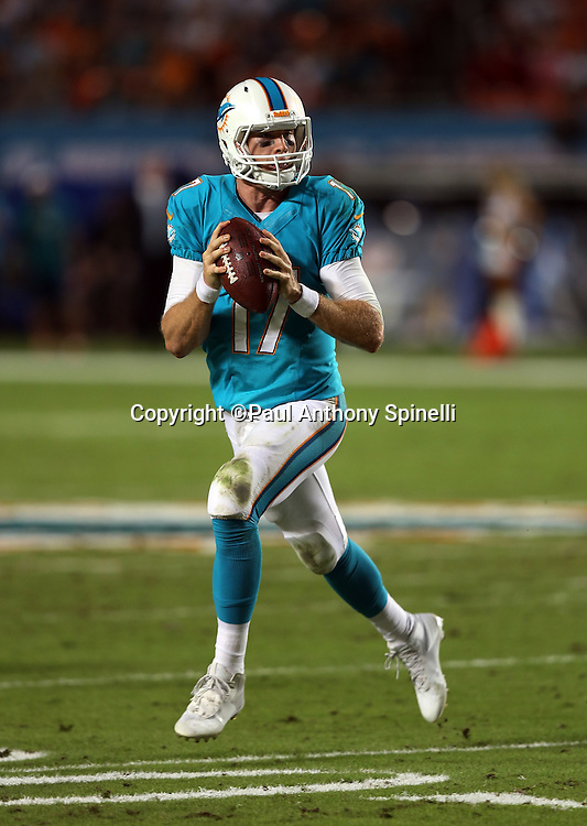 Miami Dolphins quarterback Ryan Tannehill (17) rolls out and throws a second quarter pass good for a first down at the Cincinnati Bengals 15 yard line during the NFL week 9 football game against the Cincinnati Bengals on Thursday, Oct. 31, 2013 in Miami Gardens, Fla.. The Dolphins won the game 22-20 in overtime. ©Paul Anthony Spinelli