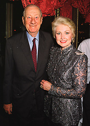 Singer PATRICIA COOK and her husband EDWARD COOK,  at a reception in London on 26th March 1998.MGJ 108