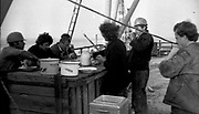 """AMAZING Photo Film discovered Documenting Work In Chernobyl <br />Chernobyl worker Aleksandr Shubovskiy captures rare images <br /><br />During one of the days in 1979-80, when the erection of Ventilation Stack VT-2 common for the third and fourth (not existed at that time) Chernobyl NPP Units was coming to the end, Aleksandr Shubovskiy, who was working within a combined installation crew in a company named """"Spetsenergomontazh"""", arranged with the colleagues a small photo session on his own,They had their pictures taken.<br /><br />The author processed the film and put it on a wardrobe without printing until he had time to print the images. The moment to print the film somehow did not happen, while in February 1986 Aleksandr hit the road for a on a different site in Yakutia. And there he was caught by news about the accident at Chernobyl.<br /><br />A year later, when a Aleksandr  managed to get into his looted flat in the evacuated Pripyat, he discovered an untouched package with films. He brought them home and… forgot for almost 40 years…the printed photographs which no one and never have seen before until now<br /><br />Photo shows: VT–2 height — more than 150 meters — it is 40-storeyed house. At the moment of pictures' taking a crew was working at mark 74. Lunch was lifted by a crane directly onto the roof in order not to make forced marches once again up and down the stairs to a canteen (""""Romashka"""" or """"Fialka"""") and back.<br />©Aleksandr Shubovskiy/Exclusivepix Media"""