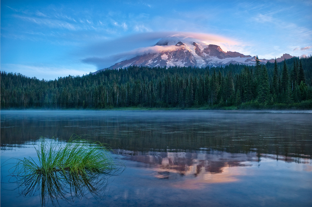 Mount Rainier with lenticular cloud from Reflection Lake; Mount Rainier National Park, Washington, USA.