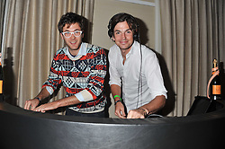 Left to right, ISAAC FERRY and HUGO HEATHCOTE at the Veuve Clicquot Mint Polo in The Park after party held at The Hurlingham Club, Ranelagh Gardens, London SW6 on 5th June 2011.