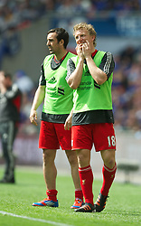 LONDON, ENGLAND - Saturday, April 14, 2012: Liverpool's substitutes Dirk Kuyt and Jose Enrique during the FA Cup Semi-Final match against Everton at Wembley. (Pic by David Rawcliffe/Propaganda)