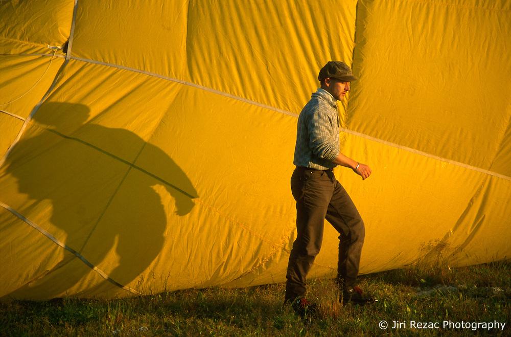 GERMANY SCHLESWIG-HOLSTEIN KIEL 9JUN02 - Pilot Andreas Kuehl next to the inflating hull of his balloon...jre/Photo by Jiri Rezac..© Jiri Rezac 2002..Contact: +44 (0) 7050 110 417..Mobile:  +44 (0) 7801 337 683.Office:  +44 (0) 20 8968 9635..Email:   jiri@jirirezac.com.Web:     www.jirirezac.com