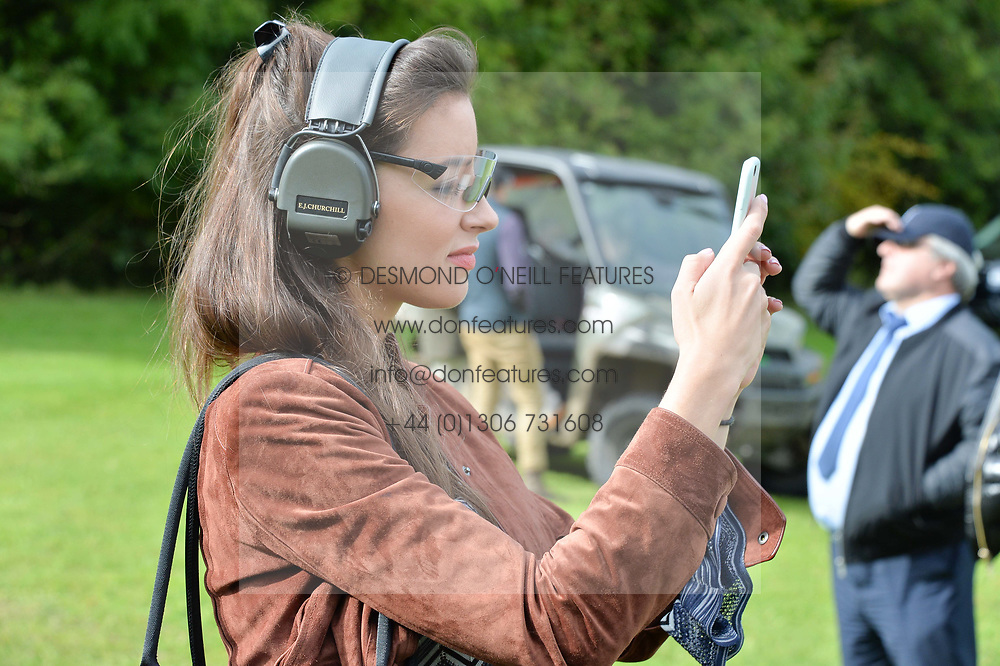 Olivia Santoro at Young Guns raising money for the fight against breast cancer trough Cancer Research UK held at EJ Churchill Shooting School followed by lunch at West Wycombe Park, England. 23 September 2017.