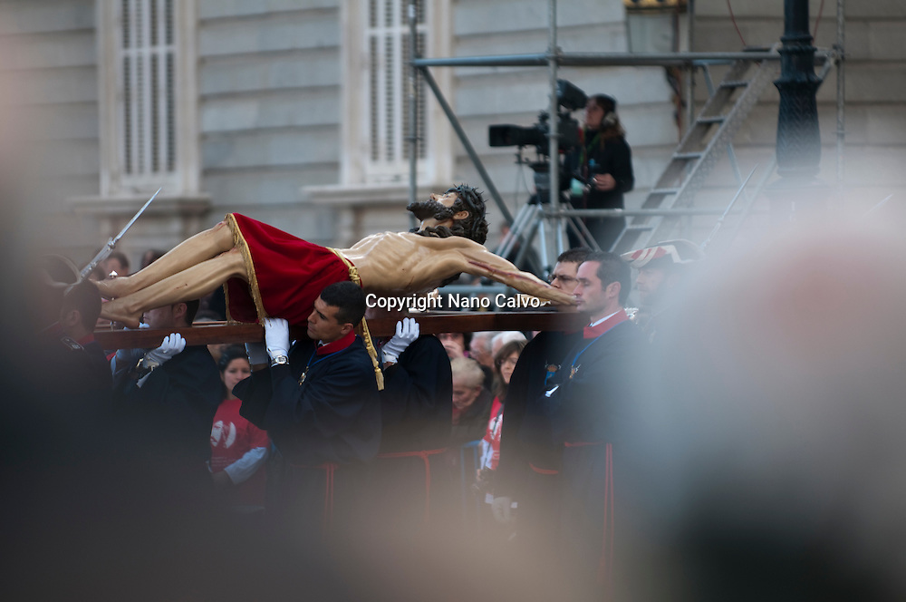 Christ on the way to Calvary, a christian parade in Plaza de Oriente of Madrid, during spanish Holy Week. <br /> <br /> Many people assisted to the popular Via Crucis, including the presence of Cardinal Antonio Mar&iacute;a Rouco Varela, Archbishop of Madrid.