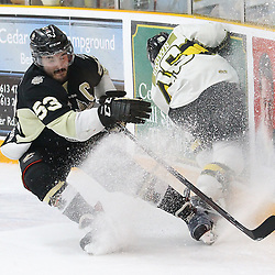 "TRENTON, ON  - MAY 2,  2017: Canadian Junior Hockey League, Central Canadian Jr. ""A"" Championship. The Dudley Hewitt Cup Game 2 between Trenton Golden Hawks and Powassan Voodoos.    Josh Allan #53 of the Trenton Golden Hawks stops to avoid  Rhys Brown #16 of the Powassan Voodoos who goes hard into the boards during the second period <br /> (Photo by Alex D'Addese / OJHL Images)"