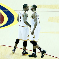 08 June 2016: Cleveland Cavaliers center Tristan Thompson (13) is congratulated by Cleveland Cavaliers guard J.R. Smith (5) during the Cleveland Cavaliers 120-90 victory over the Golden State Warriors, during Game Three of the 2016 NBA Finals at the Quicken Loans Arena, Cleveland, Ohio, USA.