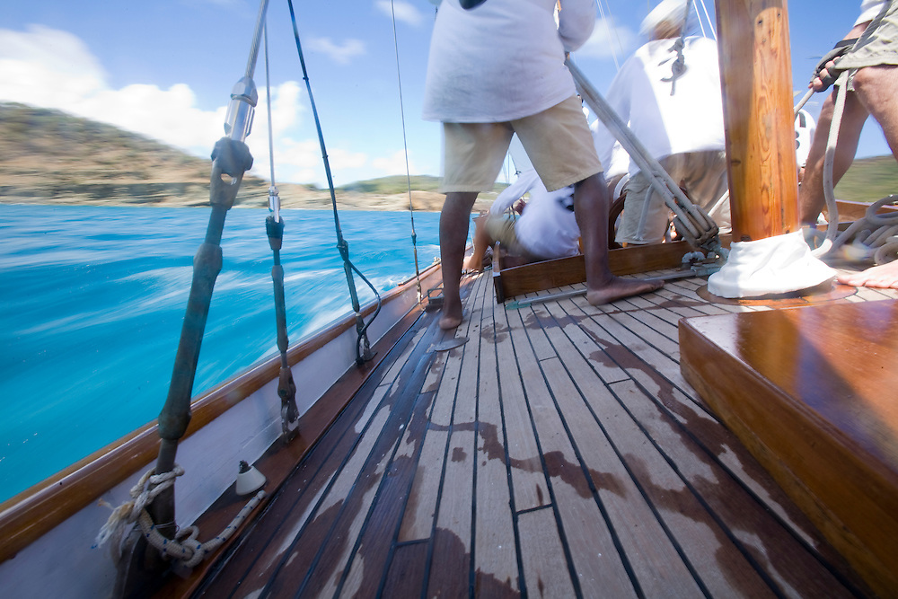 Speeding past the land during the 2008 Antigua Classic Yacht Regatta . This race is one of the worlds most prestigious traditional yacht races. It takes place annually off the cost of Antigua in the British West Indies. Antigua is a yachting haven, historically a british navy base in the times of Nelson.