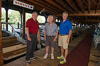 Bruce Wright, Jack Irwin and Bill Irwin on the docks at Irwin Marine on Lake Winnipesaukee. (Karen Bobotas for New England Boating Magazine)