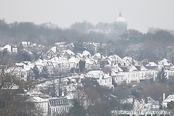 © Licensed to London News Pictures. 01/02/2019. London, UK. Snow-covered roofs seen from Hampstead Heath, north London, after snow fell overnight. Photo credit: Rob Pinney/LNP