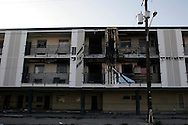 The burnt out shell of the Economy Inn on Tulane Avenue stands as a grisly reminder of the chronic homelessness problem in New Orleans on April 12, 2007. The hotel caught on fire twice over the winter as people tried to stay warm. Yet even with this risk the abandoned hotel is home to over a dozen people.