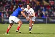 England player Abbie Scott try to break a French tackle in the first half during the Women's 6 Nations match between England Women and France Women at the Keepmoat Stadium, Doncaster, England on 10 February 2019.