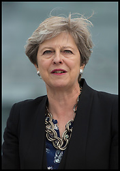 August 16, 2017 - Portsmouth, Hampshire, United Kingdom - The Prime Minister of the United Kingdom THERESA MAY makes a speech to the ship's crew on the flight deck of HMS Queen Elizabeth on the ship's first day at its home in Portsmouth Naval Base, Portsmouth Hampshire, UK. (Credit Image: © Ben Stevens/i-Images via ZUMA Press)