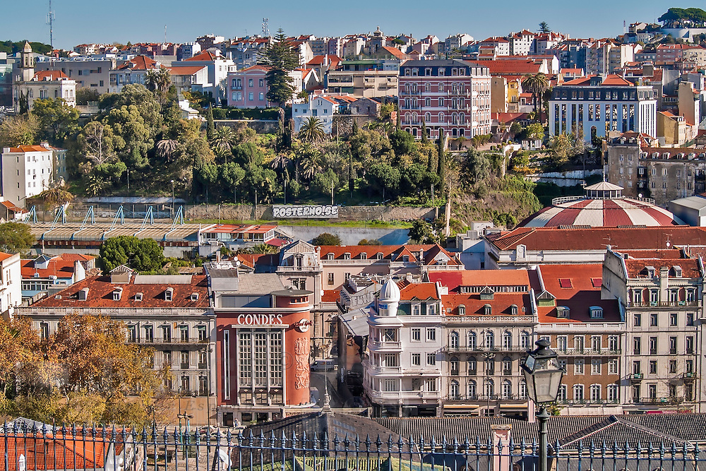Lisbon, November 2012. General view of downtown and hills from Bairro Alto district, with the ancient cinema Condes, today the Hard Rock Cafe