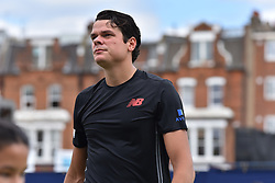 June 19, 2018 - London, England, United Kingdom - Canada's Milos Raonic reacts to India's Yuki Bhambri during their first round men's singles match at the ATP Queen's Club Championships tennis tournament in west London on June 19, 2018. (Credit Image: © Alberto Pezzali/NurPhoto via ZUMA Press)