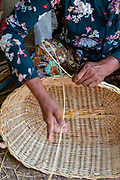 A woman makes wicker baskets. Prasat Bakang, Siem Reap, Cambodia.