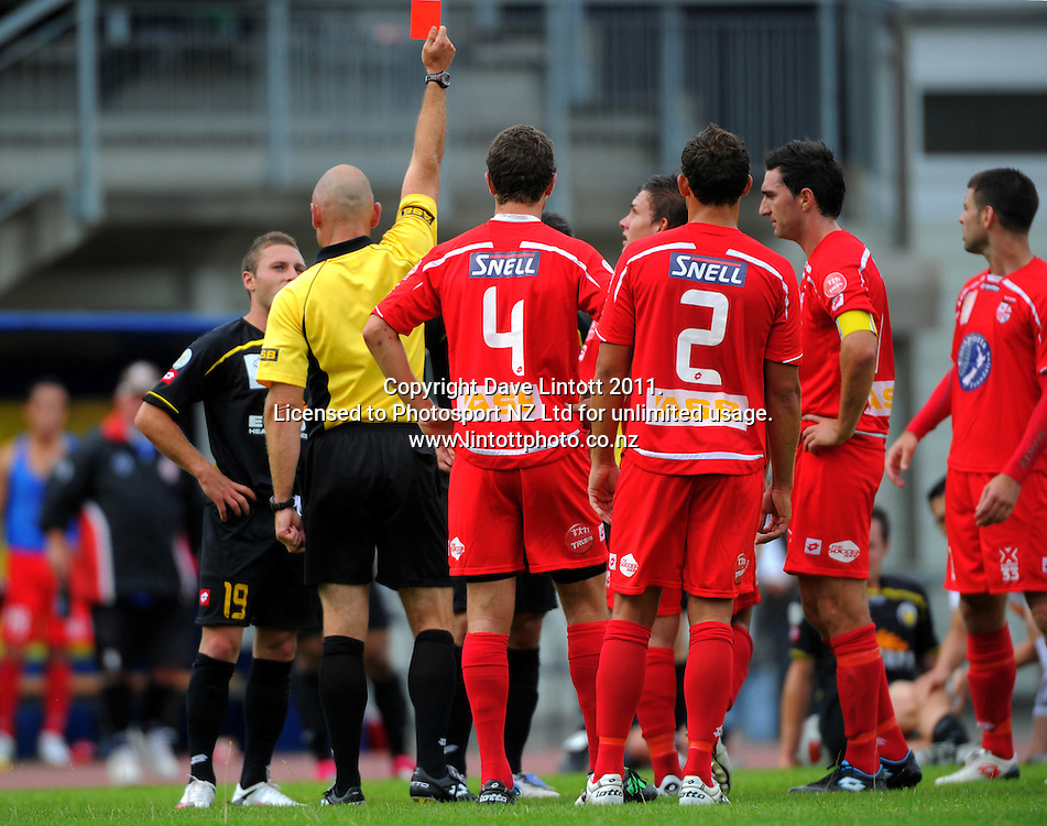 Referee Mike Hester red cards Wellington's George Barbarouses. ASB Premiership soccer  - Team Wellington v Waitakere United at Newtown Park, Wellington, New Zealand on Saturday, 22 January 2011. Photo: Dave Lintott / photosport.co.nz