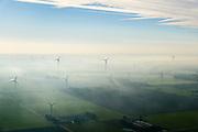 Nederland, Flevoland, Lelystad, 04-11-2018; Maximacentrale (voorheen Flevocentrale) van Engie Nederland, op een eigen kunstmatig aangelegd eiland in het IJsselmeer. Twee nieuwe stoom- en gaseenheden (STEG) met aardgas als brandstof, relatief schoon en met hoog-rendement.<br /> Naast de centrale het nieuw aangelegde zonnepark met zonnecollectoren, op de plaats van de oude centrale.<br /> Maxima power plant (formerly Flevocentrale) of Electrabel, on its own artificial island in the IJsselmeer. Two new steam and gas units (CCGT) with natural gas as fuel, relatively clean and high-efficiency (combined cycle units).<br /> Next to the power plant, the newly constructed solar park, on the site of the old power plant.<br /> <br /> luchtfoto (toeslag op standaard tarieven);<br /> aerial photo (additional fee required);<br /> copyright&copy; foto/photo Siebe Swart