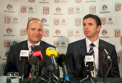 CARDIFF, WALES - Wednesday, January 12, 2011: Wales' Chief-Executive Jonathan Ford and new manager Gary Speed during a press conference to announce that British car manufacturer Vauxhall is to become the official leading sponsorship partner to the Wales international football teams, at Cardiff City Stadium. (Pic by: David Rawcliffe/Propaganda).+++ THIS IMAGE IS FREE TO USE IN CONJUNCTION WITH EDITORIAL OF VAUXHALL'S SPONSORSHIP OF THE FAW. +++