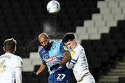Wycombe Wanderers forward Josh Parker (27) heads the ball  under pressure from Milton Keynes Dons defender George Williams (2) during the EFL Trophy match between Milton Keynes Dons and Wycombe Wanderers at stadium:mk, Milton Keynes, England on 12 November 2019.