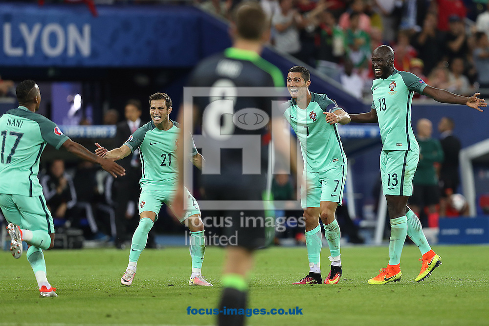 Nani of Portugal runs to Cristiano Ronaldo of Portugal, Danilo of Portugal and Cedric of Portugal to celebrate their side&rsquo;s 2nd goal during the UEFA Euro 2016 semi-final match at Stade de Lyons, Lyons<br /> Picture by Paul Chesterton/Focus Images Ltd +44 7904 640267<br /> 06/07/2016