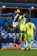 Birmingham City midfielder David Davis  and Huddersfield Town midfielder Sean Scannell battle for a header during the Sky Bet Championship match between Birmingham City and Huddersfield Town at St Andrews, Birmingham, England on 5 December 2015. Photo by Alan Franklin.