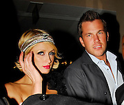 15.APRIL.2009. LONDON<br /> <br /> AMERICAN SOCIALITE PARIS HILTON LEAVES HER HOTEL WITH NEW BOYFRIEND DOUG REINHARDT AND HEADS TO THE WOOLSLEY RESTAURANT, MAYFAIR BEFORE HEADING ACROSS THE ROAD TO MAHIKI CLUB WHERE THEY PARTIED TILL 2.15AM AND HAD A BIG SNOG IN THE BACK OF THE CAR BEFORE HEADING TO THERE 2ND CLUB OF THE NIGHT JALOUSE CLUB, MAYFAIR WHERE THEY STAYED TILL 3.30AM AND LEFT LOOKING A BIT WORSE FOR WEAR BEFORE GOING BACK TO THERE HOTEL.<br /> <br /> BYLINE: EDBIMAGEARCHIVE.COM<br /> <br /> *THIS IMAGE IS STRICTLY FOR UK NEWSPAPERS AND MAGAZINES ONLY*<br /> *FOR WORLD WIDE SALES AND WEB USE PLEASE CONTACT EDBIMAGEARCHIVE - 0208 954 5968*