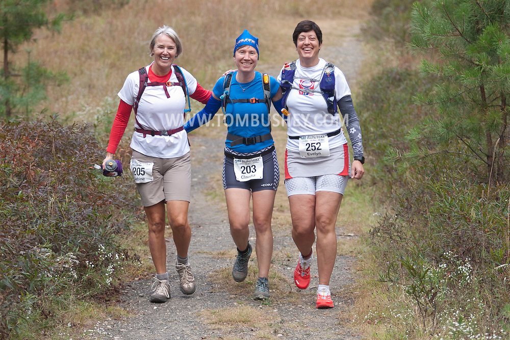 Kerhonkson, New York - Sabine Kuehn, Claudia Cummings and Evelyn Heinbach move through Minnewaska State Park Preserve during the Shawangunk Ridge Trail Run/Hike 20-mile race on Sept. 20, 2014.