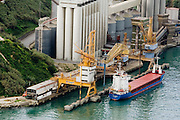 A cargo ship or freighter is any sort of ship or vessel that carries cargo, goods, and materials from one port to another