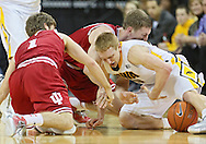 December 31 2012: Indiana Hoosiers guard Jordan Hulls (1), Indiana Hoosiers forward Cody Zeller (40), and Iowa Hawkeyes guard Mike Gesell (10) battle for a lose ball during the second half of the NCAA basketball game between the Indiana Hoosiers and the Iowa Hawkeyes at Carver-Hawkeye Arena in Iowa City, Iowa on Monday December 31, 2012. Indiana defeated Iowa 69-65.
