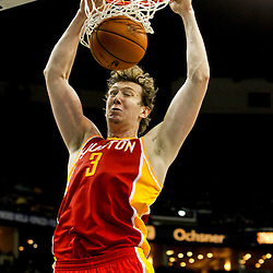 Jan 9, 2013; New Orleans, LA, USA; Houston Rockets center Omer Asik (3) dunks against the New Orleans Hornets during  the third quarter of a game at the New Orleans Arena. The Hornets defeated the Rockets 88-79. Mandatory Credit: Derick E. Hingle-USA TODAY Sports