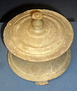 Marble pyxis (jewellery Box). This simple, turned marble box sits on three small feet.  It may well originally have had additional decoration in paint.  Small vessels of various shapes carved from marble have been found in fourth-century tombs all over the Greek world.  About 350 BC