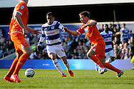 Queens Park Rangers Ravel Morrison competes with Blackpool's Tony McMahon. Skybet football league championship match , Queens Park Rangers v Blackpool at Loftus Road in London  on Saturday 29th March 2014.<br /> pic by John Fletcher, Andrew Orchard sports photography.
