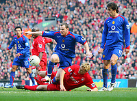 Wayne Rooney is tackled by Liverpool's Sami Hyypia<br />Manchester United 2005/06<br />Liverpool V Manchester United 18/02/06<br />The F/A Cup 5th Round<br />Photo Robin Parker Fotosports International