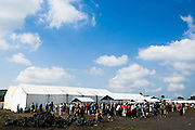 Internally displaced people wait in line to register for re-location to a new camp in Mugunga, on the other side of Goma, at the Kibati IDP camp, on the outskirts of Goma, Eastern Democratic Republic of Congo on Friday December 12, 2008. People from the Kibati camp are being relocated because the camp is located between government troops and the rebel held territory north of Goma.