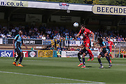 James Berrett meets the ball for a header during the Sky Bet League 2 match between Wycombe Wanderers and York City at Adams Park, High Wycombe, England on 8 August 2015. Photo by Simon Davies.