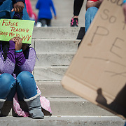 Destiny Carpenter holds a sign outside of the capitol building on the fourth day of statewide walkouts in Charleston, W.V., on Tuesday, February 27, 2018.