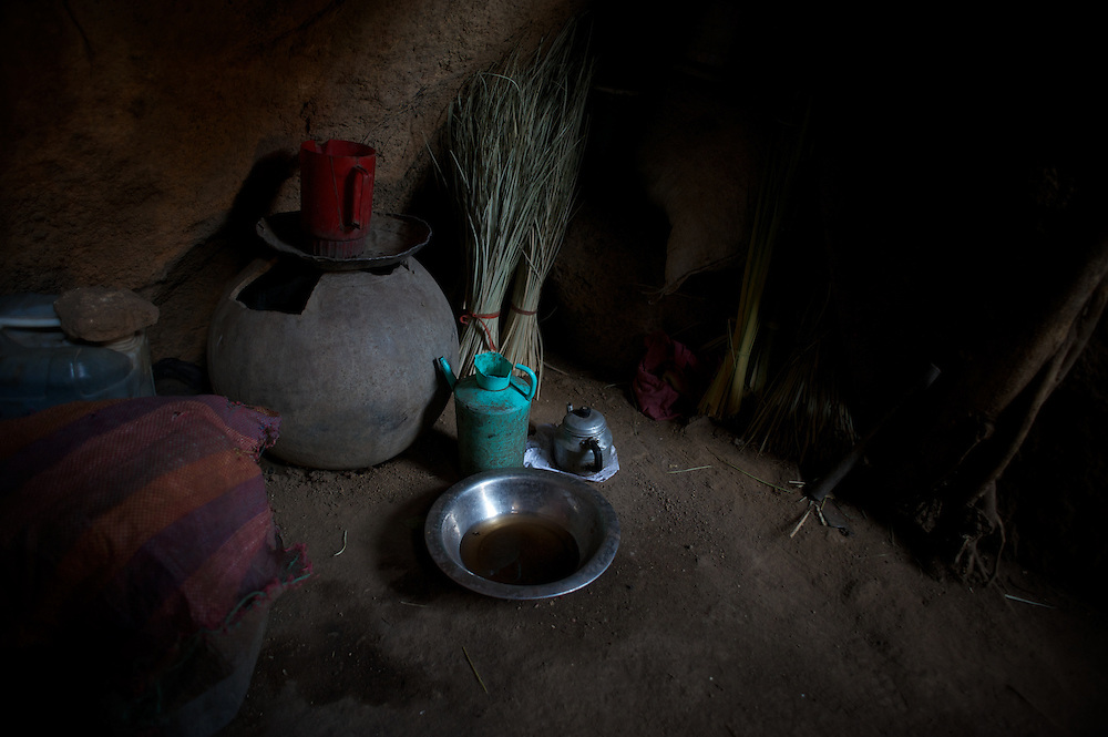 April 28, 2012 - Buram, Nuba Mountains, South Kordofan, Sudan: Kitchen utensils are seen in the floor of a improvised home in a cave of the mountains outside Buram village in South Kordofan's Nuba Mountains...Since the 6th of June 2011, the Sudan's Army Forces (SAF) initiated, under direct orders from President Bashir, an attack campaign against civil areas throughout the South Kordofan's province. Hundreds have been killed and many more injured...Local residents, of Nuba origin, have since lived in fear and the majority moved from their homes to caves in the nearby mountains. Others chose to find refuge in South Sudan, driven by the lack of food cause by the agriculture production halt due to the constant bombardments of rural areas. (Paulo Nunes dos Santos/Polaris)