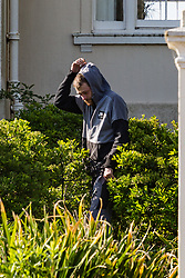 A man emerges from his tent in the council-owned grounds of Beach House in Worthing, West Sussex, where homeless campers have been living for several weeks. Worthing, West Sussex, April 30 2019.