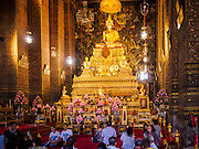 26 FEBRUARY 2017 - BANGKOK, THAILAND: People in a prayer hall at Wat Pho.         PHOTO BY JACK KURTZ