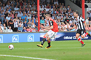 Tom Barkhuizen (9) of Morecambe Town puts ball forward Sean McAllister (4) of Grimsby Town cases him down during the EFL Sky Bet League 2 match between Grimsby Town FC and Morecambe at Blundell Park, Grimsby, United Kingdom on 6 August 2016. Photo by Ian Lyall.