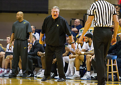 Nov 28, 2016; Morgantown, WV, USA; West Virginia Mountaineers head coach Bob Huggins yells at an official during the first half against the Manhattan Jaspers at WVU Coliseum. Mandatory Credit: Ben Queen-USA TODAY Sports