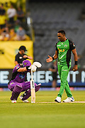 14th January 2019, Melbourne Cricket Ground, Melbourne, Australia; Australian Big Bash Cricket, Melbourne Stars versus Hobart Hurricanes;  Dwayne Bravo of the Melbourne Stars congratulates D'Arcy Short of the Hobart Hurricanes on his innings of 96 not out