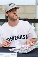 KELOWNA, CANADA - JUNE 28: NHL New Jersey Devils player Damon Severson signs an autograph table during the opening charity game of the Home Base Slo-Pitch Tournament fundraiser for the Kelowna General Hospital Foundation JoeAnna's House on June 28, 2019 at Elk's Stadium in Kelowna, British Columbia, Canada.  (Photo by Marissa Baecker/Shoot the Breeze)