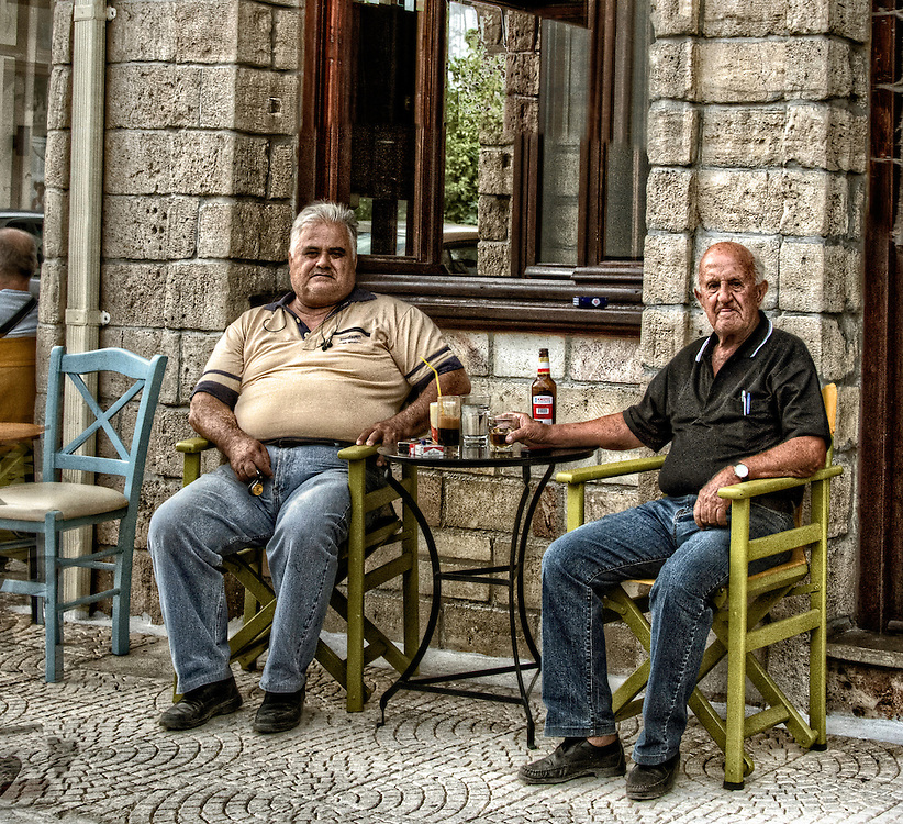Street shot of two men drinking beer and coffee