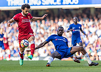 Football - 2017 / 2018 Premier League - Chelsea vs. Liverpool<br /> <br /> Antonio Rudiger (Chelsea FC) gets a foot to the ball before Mohamed Salah (Liverpool FC) can cause any danger at Stamford Bridge <br /> <br /> COLORSPORT/DANIEL BEARHAM