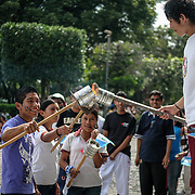 As part of the celebrations for Guatemalan Independence Day, on the day before groups of older school students in their running gear converge on Parque Central. Organized into school groups, they select one from their class to light the ceremonial torch symbolizing Guatemalan freedom and independence and then lead the class in running through the streets toward their home villages.